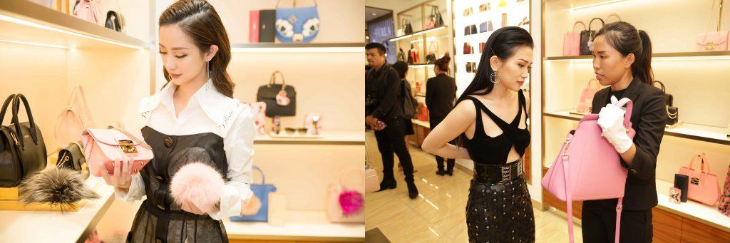 Ca sỹ Sĩ Thanh và diễn viên Jun Vũ thích thú với tranh ký họa của mình tại event.